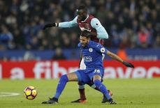 """Britain Football Soccer - Leicester City v West Ham United - Premier League - King Power Stadium - 31/12/16 Leicester City's Riyad Mahrez in action with West Ham United's Cheikhou Kouyate  Reuters / Darren Staples Livepic EDITORIAL USE ONLY. No use with unauthorized audio, video, data, fixture lists, club/league logos or """"live"""" services. Online in-match use limited to 45 images, no video emulation. No use in betting, games or single club/league/player publications.  Please contact your account representative for further details."""