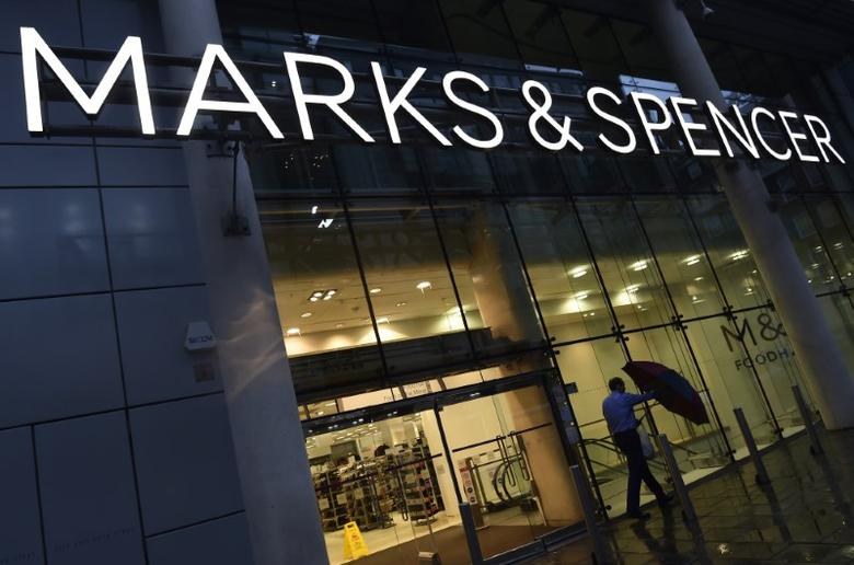 A man leaves a Marks & Spencer store in London, Britain January 7, 2016. REUTERS/Toby Melville