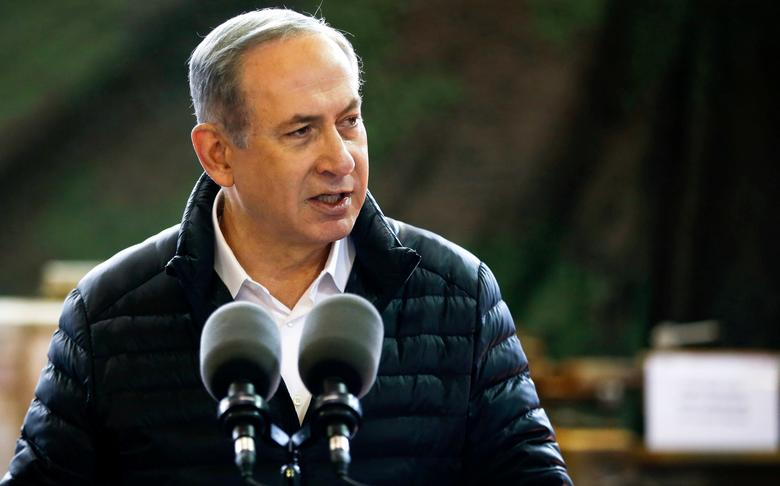 Israeli Prime Minister Benjamin Netanyahu speaks during a visit to an army base in the West Bank settlement of Beit El near Ramallah January 10, 2017.  REUTERS/Baz Ratner