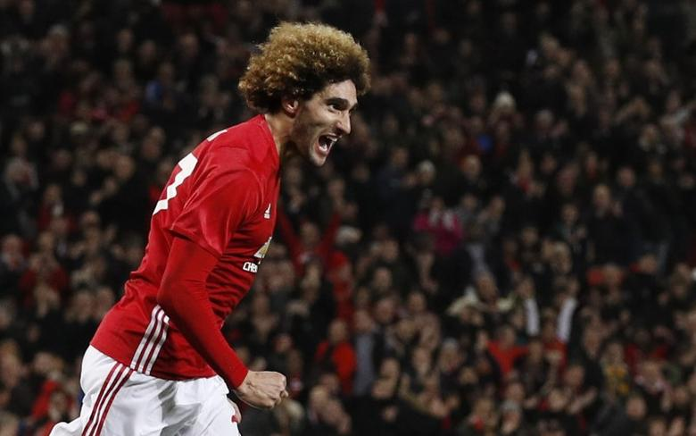 Britain Football Soccer - Manchester United v Hull City - EFL Cup Semi Final First Leg - Old Trafford - 10/1/17 Manchester United's Marouane Fellaini celebrates scoring their second goal  Reuters / Phil Noble