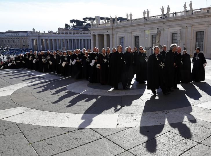 Members of the Order of the Knights of Malta arrive in St. Peter Basilica for their 900th anniversary in Vatican February 9, 2013. REUTERS/Alessandro Bianchi