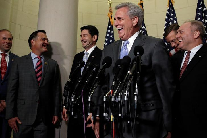 U.S. House Majority Leader Kevin McCarthy (R-CA) laughs as he and House Speaker Paul Ryan, flanked by House Republican Whip Steve Scalise (R-LA), introduce Representative Jason Smith (R-MO) and Representative Luke Messer (R-IN) as new members of the House Republican leadership team after their caucus held leadership elections on Capitol Hill in Washington, U.S. November 15, 2016. REUTERS/Jonathan Ernst