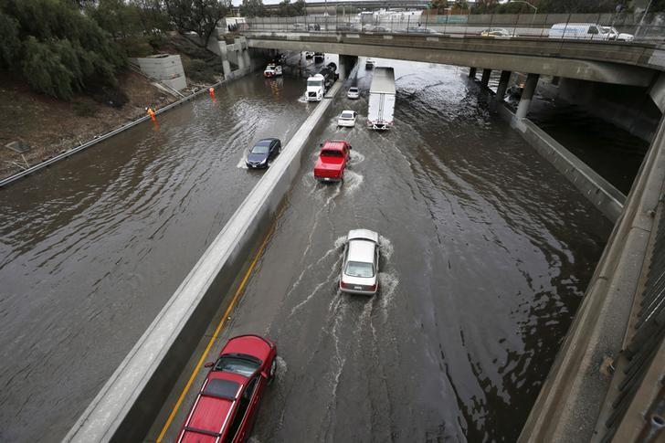 Vehicles drive on the flooded 5 freeway after an El Nino-strengthened storm brought rain to Los Angeles, California, United States, January 6, 2016. REUTERS/Lucy Nicholson/Files