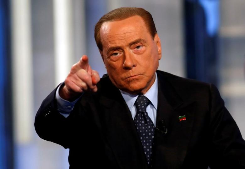Italy's former Prime Minister Silvio Berlusconi gestures as he attends television talk show ''Porta a Porta'' (Door to Door) in Rome, Italy, November 30, 2016. REUTERS/Remo Casilli     TPX IMAGES OF THE DAY - RTSU3KH