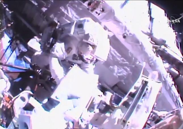 Two astronauts floated outside the International Space Station on Friday for a 6-1/2-hour spacewalk to replace aging batteries for the laboratory's solar power system, an upgrade needed to keep the outpost running into the next decade.  NASA via REUTERS