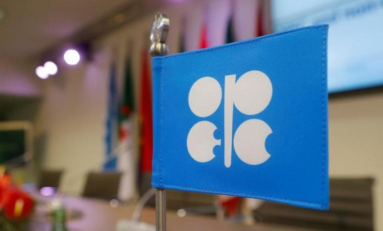 FILE PHOTO -  A flag with the Organization of the Petroleum Exporting Countries (OPEC) logo is seen before a news conference at OPEC's headquarters in Vienna, Austria December 10, 2016. REUTERS/Heinz-Peter Bader/File Photo