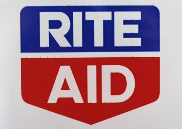 A Rite Aid logo is seen outside one of their stores in New York, April 11, 2013.   REUTERS/Shannon Stapleton