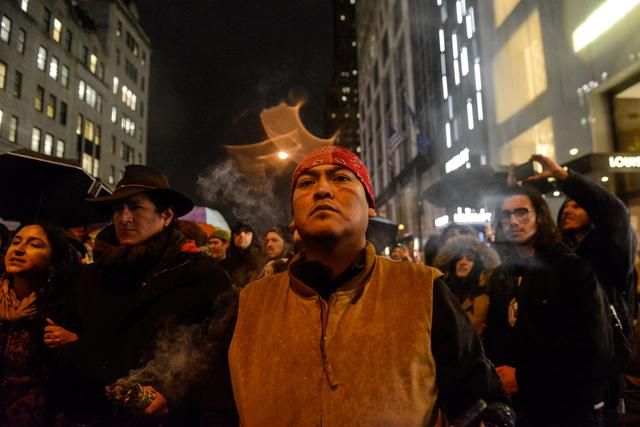 People participate in a protest against President Donald Trump's executive order to allow the Keystone XL and Dakota Access pipelines in New York City, U.S. January 24, 2017. REUTERS/Stephanie Keith