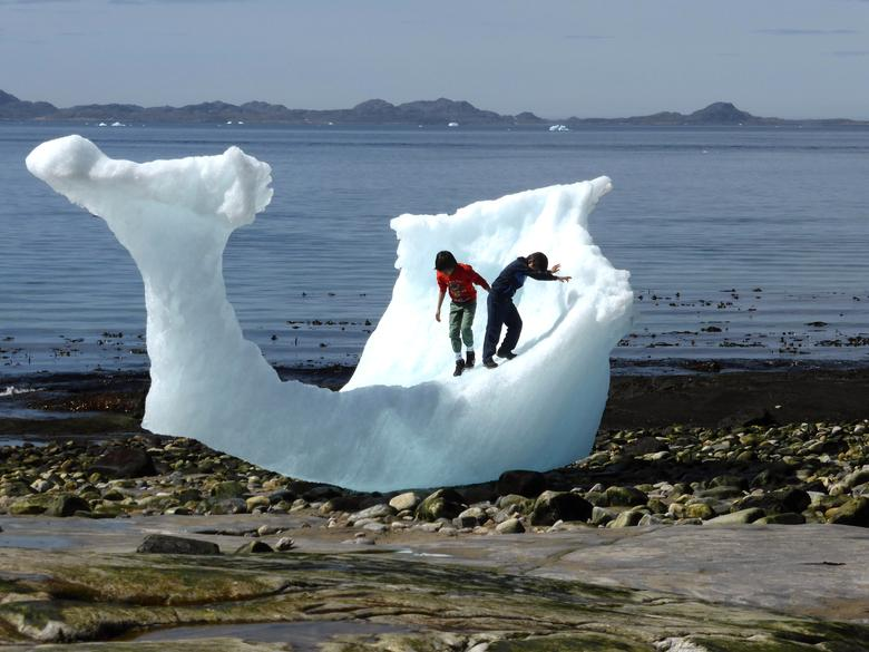 Children play amid icebergs on the beach in Nuuk, Greenland, June 5, 2016. REUTERS/Alister Doyle