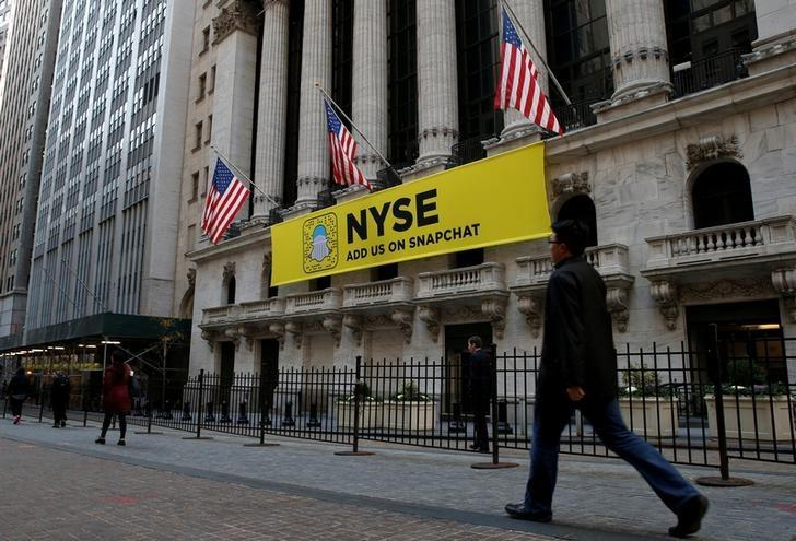 File Photo: The Snapchat logo is seen on a banner outside the New York Stock Exchange (NYSE) in New York City, U.S., November 16, 2016.  REUTERS/Brendan McDermid/File Photo