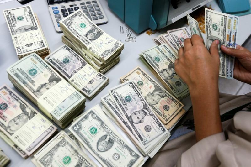 A Bank Employee Counts U S Dollar Notes At Kasikornbank In Bangkok Thailand May 12 2016 Reuters Athit Perawongmetha