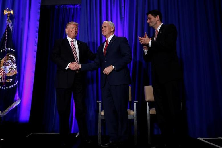 U.S. President Donald Trump is greeted by Vice President Mike Pence and House Speaker Paul Ryan (R) as he arrives to speak at a congressional Republican retreat in Philadelphia, U.S. January 26, 2017.  REUTERS/Jonathan Ernst