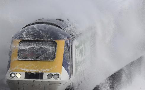 Giant waves smash British commuter train