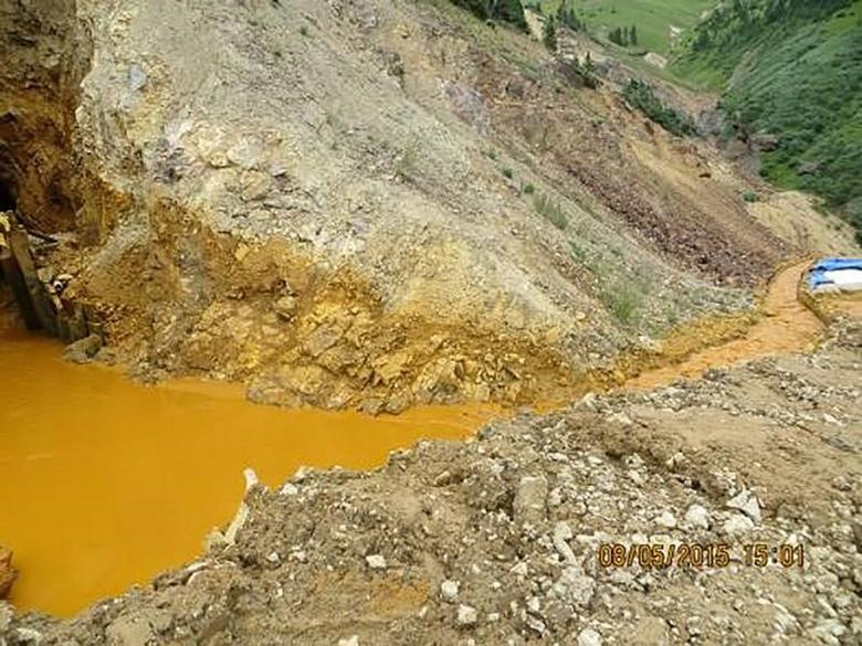 Yellow mine waste water is seen at the entrance to the Gold King Mine in San Juan County, Colorado, in this picture released by the Environmental Protection Agency (EPA) taken August 5, 2015.   REUTERS/EPA/Handout/File Photo