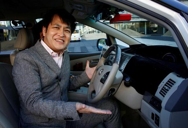 ZMP CEO Hisashi Taniguchi poses in his company's RoboCar during its demonstration in Tokyo, Japan, January 31, 2017.  Picture taken on  January 31, 2017.  REUTERS/Kim Kyung-Hoon - RTX2ZFGC