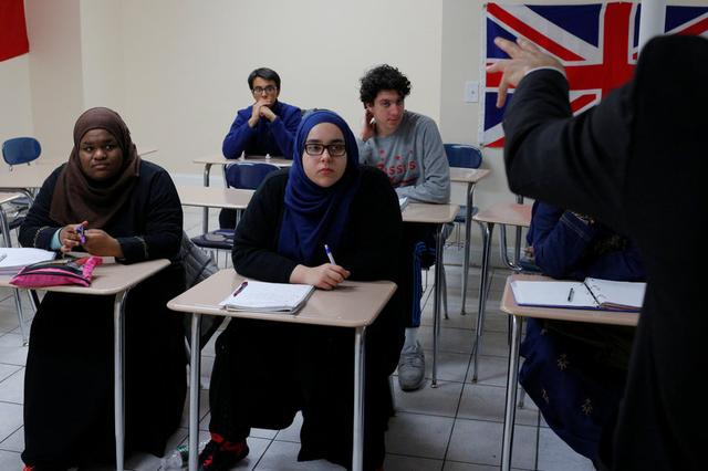 Nadeem Mazen, Cambridge city councillor, Muslim and founder of JetPAC, speaks to students in the AP Government class at Al-Noor Islamic high school in Mansfield, Massachusetts, U.S. February 2, 2017.  REUTERS/Brian Snyder