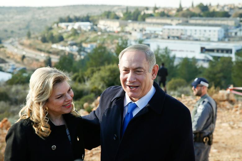 Israeli Prime Minister Benjamin Netanyahu and his wife Sara pose for photographers after a memorial ceremony for late mayor of Ariel, Ron Nachman, in the Israeli settlement of Ariel in the occupied West Bank February 2, 2017. REUTERS/Baz Ratner