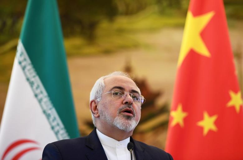 Iranian Foreign Minister Mohammad Javad Zarif speaks during a news conference with his Chinese counterpart Wang Yi in Beijing, China December 5, 2016. REUTERS/Greg Baker/Pool/Files