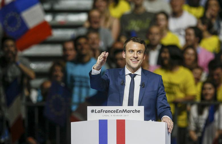 Emmanuel Macron, head of the political movement En Marche !, or Onwards !, and candidate for the 2017 presidential election, attends a campaign rally in Lyon, France, February 4, 2017. REUTERS/Robert Pratta