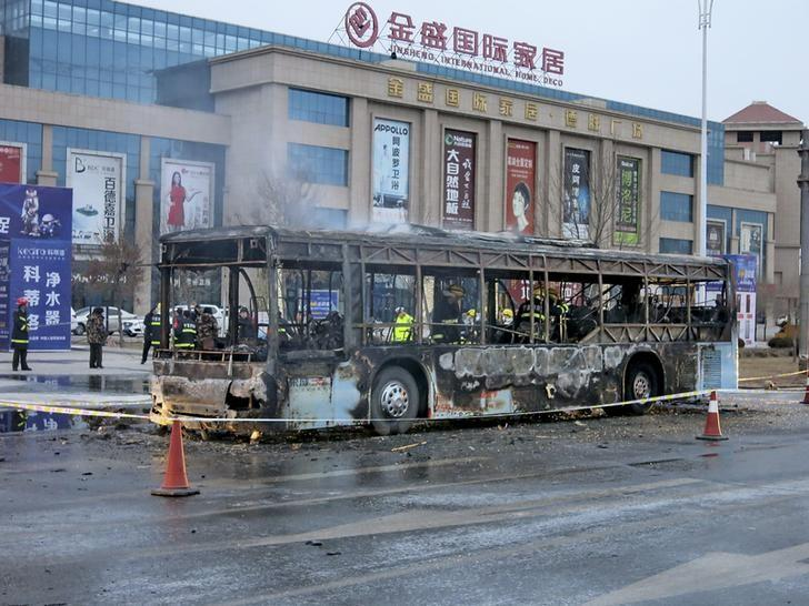 Firefighters are seen working inside a burnt bus after a fire on a street in Yinchuan, Ningxia Hui Autonomous Region, China, January 5, 2016. REUTERS/Stringer /Files