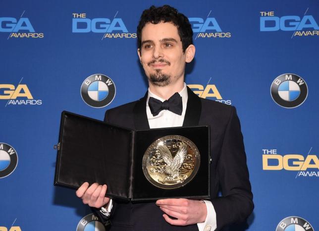 2月5日、米アカデミー賞の行方を占う全米監督協会(DGA)賞の授賞式が4日夜開催され、ロサンゼルスを舞台としたミュージカル映画「ラ・ラ・ランド」(日本公開2月24日)のデイミアン・チャゼル監督が長編映画監督賞を受賞した(2017年 ロイター/Phil McCarten)