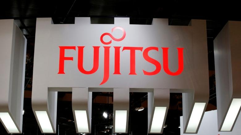 A logo of Fujitsu is pictured at CEATEC (Combined Exhibition of Advanced Technologies) JAPAN 2016 at the Makuhari Messe in Chiba, Japan, October 3, 2016.   REUTERS/Toru Hanai/File Photo