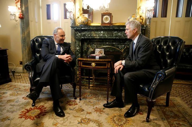 U.S. Senate Minority Leader Chuck Schumer (D-NY) (L) meets with U.S. Supreme Court nominee Judge Neil Gorsuch (R) in Schumer's office at the U.S. Capitol in Washington, U.S. February 7, 2017.  REUTERS/Jonathan Ernst