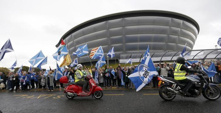 Motorcyclists drive past a pro-Independence rally held outside the SNP conference in Glasgow, Scotland October 15, 2016. REUTERS/Russell Cheyne/File Photo