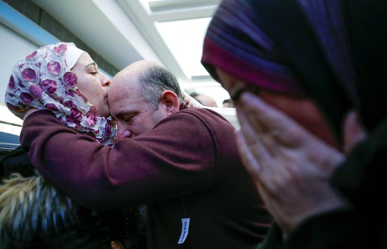 Syrian refugee Baraa Haj Khalaf (L) kisses her father Khaled as her mother Fattoum (R) cries after arriving at O'Hare International Airport in Chicago, Illinois, U.S. February 7, 2017. REUTERS/Kamil Krzaczynski