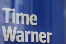 """Логотип Time Warner в салоне Time Warner в Нью-Йорке. 23 октября 2016 года. Американский медиаконцерн Time Warner Inc отчитался в среду о росте квартальной выручки на 11,47 процента благодаря успеху спин-оффа фильмов о Гарри Поттере """"Фантастические твари и где они обитают"""". REUTERS/Stephanie Keith/File Photo"""
