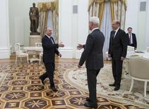 Russian President Vladimir Putin greets Volkswagen AG Chief Executive Matthias Mueller during their meeting at the Kremlin in Moscow, Russia February 8, 2017. REUTERS/Ivan Sekretarev/Pool