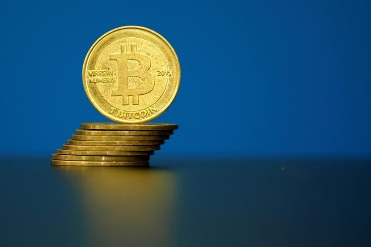 FILE PHOTO: Bitcoin (virtual currency) coins are seen in an illustration picture taken at La Maison du Bitcoin in Paris, France, May 27, 2015. REUTERS/Benoit Tessier/File Photo - RTX2YBYD