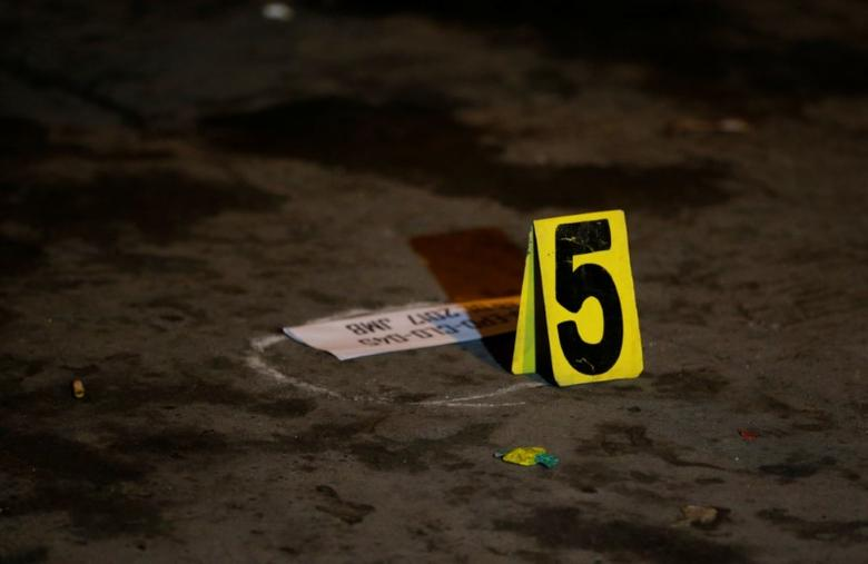 Police marking indicating fifth slug found on a crime scene after a man was killed, who police said was a drug related vigilante killing in Pasig, Metro Manila, Philippines February 1, 2017. REUTERS/Erik De Castro