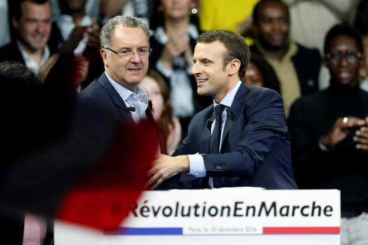 Emmanuel Macron, head of the political movement En Marche !, or Forward !, and candidate for the 2017 French presidential election, attends a political rally with French deputy Richard Ferrand in Paris, France December 10, 2016. REUTERS/Benoit Tessier/File Photo