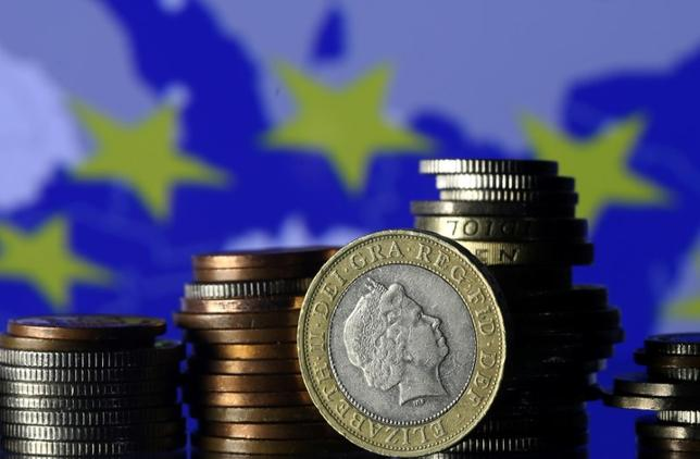 Pound coins are seen in front of a displayed EU flag in this picture illustration taken January 18, 2017.  REUTERS/Dado Ruvic/Illustration