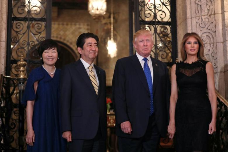 U.S. President Donald Trump, First Lady Melania Trump (R), Japanese Prime Minister Shinzo Abe and his wife Akie Abe (L) pose for a photograph before attending dinner at Mar-a-Lago Club in Palm Beach, Florida, U.S., February 11, 2017. REUTERS/Carlos Barria