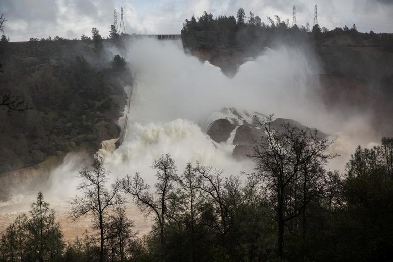 65,000 cfs of water flow through a damaged spillway on the Oroville Dam in Oroville, California. REUTERS/Max Whittaker