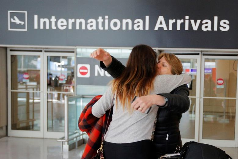 Mahnaz Kanani Zadeh (R) is greeted by her niece Negin, after traveling to the U.S. from Iran following a federal court's temporary stay of U.S. President Donald Trump's executive order travel ban, at Logan Airport in Boston, Massachusetts, U.S. February 6, 2017.   REUTERS/Brian Snyder