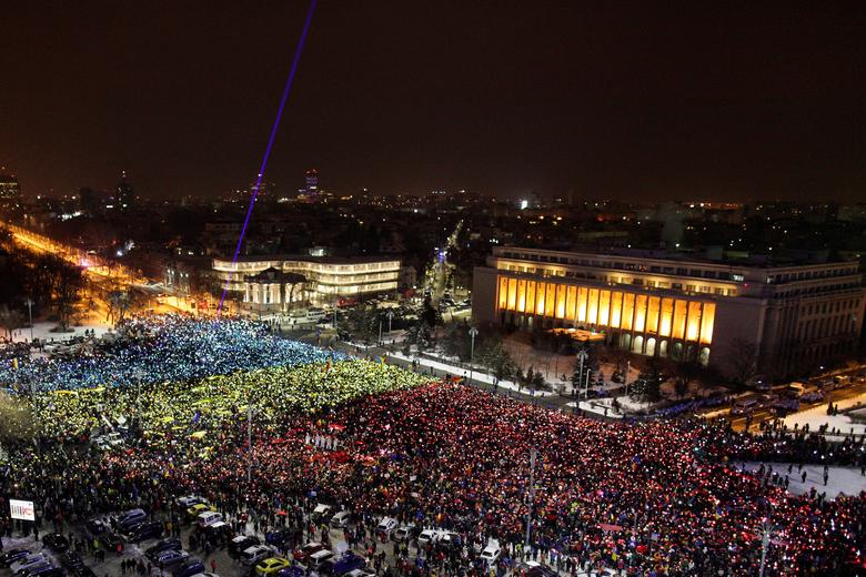 Protesters display the Romanian national flag colours during a demonstration in front of the government building in Bucharest, Romania, February 12, 2017. Inquam Photos/Liviu Florin Albei via REUTERS