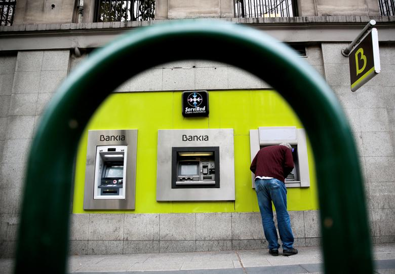 FILE PHOTO -  A man uses a cash dispenser at a Bankia branch in Madrid, Spain, April 29, 2016.  REUTERS/Andrea Comas