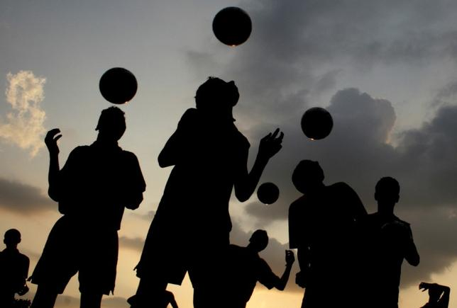 File photo: Players from a soccer academy practice against the setting sun in the northern Indian city of Chandigarh August 30, 2007. REUTERS/Ajay Verma