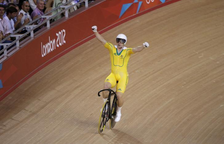 Australia's Shane Perkins celebrates after the track cycling men's sprint bronze finals at the Velodrome during the London 2012 Olympic Games August 6, 2012. REUTERS/Cathal McNaughton/Files