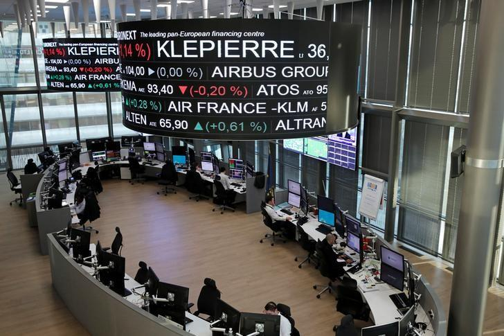 Company stock price information, including Klepierre SA, is displayed on screens as they hang above the Paris stock exchange, operated by Euronext NV, in La Defense business district in Paris, France, December 14, 2016. REUTERS/Benoit Tessier