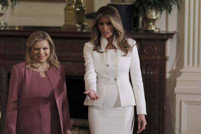 U.S. first lady Melania Trump (R) leads the way for Sara Netanyahu (L) prior to a joint news conference between their husbands, President Donald Trump and Israeli Prime Minister Benjamin Netanyahu, at the White House in Washington, U.S., February 15, 2017.   REUTERS/Carlos Barria
