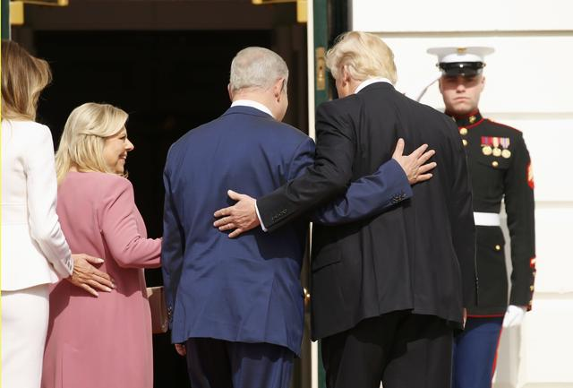 U.S. President Donald Trump (R) and first lady Melania Trump greet Israeli Prime Minister Benjamin Netanyahu and his wife Sara (2ndL) as they arrive at the South Portico of the White House in Washington, U.S., February 15, 2017. REUTERS/Kevin Lamarque