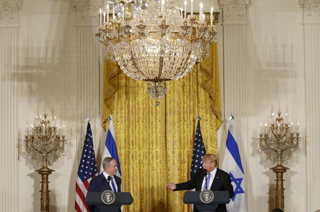 U.S. President Donald Trump (R) and Israeli Prime Minister Benjamin Netanyahu hold a joint news conference at the White House in Washington, U.S., February 15, 2017.   REUTERS/Kevin Lamarque
