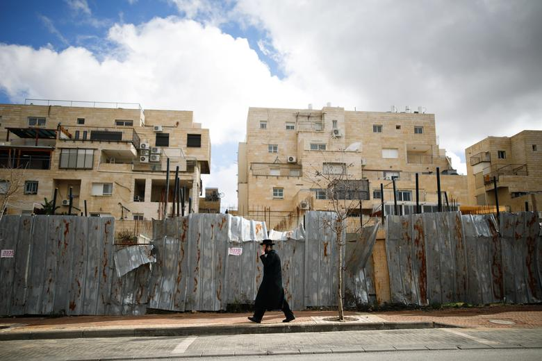 An ultra-Orthodox Jewish man walks on a road in the Israeli settlement of Beitar Illit in the occupied West Bank February 15, 2017. REUTERS/Amir Cohen