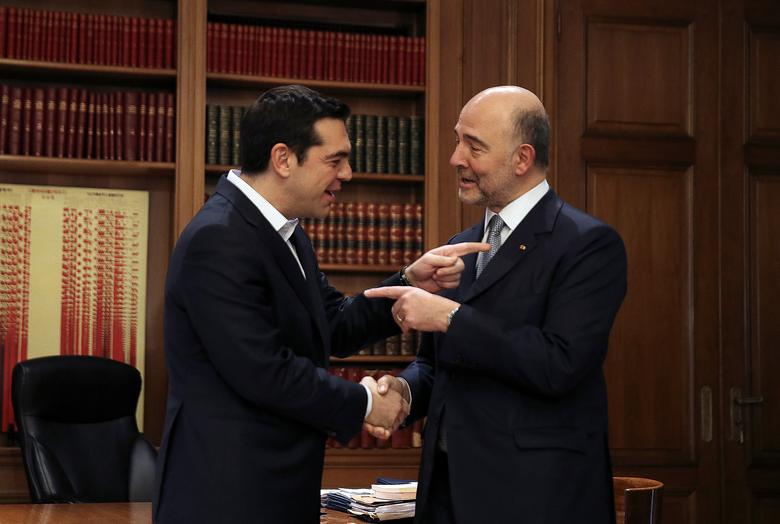 Greek Prime Minister Alexis Tsipras (L) welcomes European Economic and Financial Affairs Commissioner Pierre Moscovici at the Maximos Mansion in Athens, Greece February 15, 2017. REUTERS/Alkis Konstantinidis