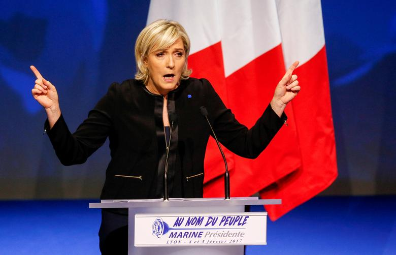 FILE PHOTO:Marine Le Pen, French National Front (FN) political party leader and candidate for the French 2017 presidential election, attends the 2-day FN political rally to launch the presidential campaign in Lyon, France February 5, 2017. REUTERS/Robert Pratta/File Photo