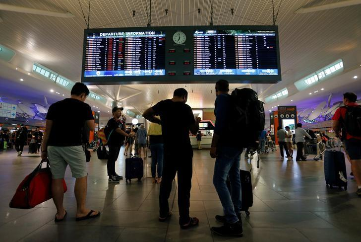 Travelers are seen at the departure hall at Kuala Lumpur International Airport 2 (KLIA2) in Sepang, Malaysia February 15, 2016. REUTERS/Lai Seng Sin